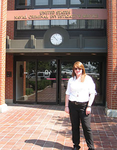 Brittney Minichino in front of U.S. Naval Criminal Investigative Service