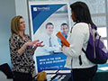 Student speaking with company representative at Career Fair