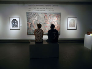 Two people viewing artwork in gallery