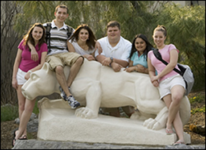 students at Nittany Lion statue