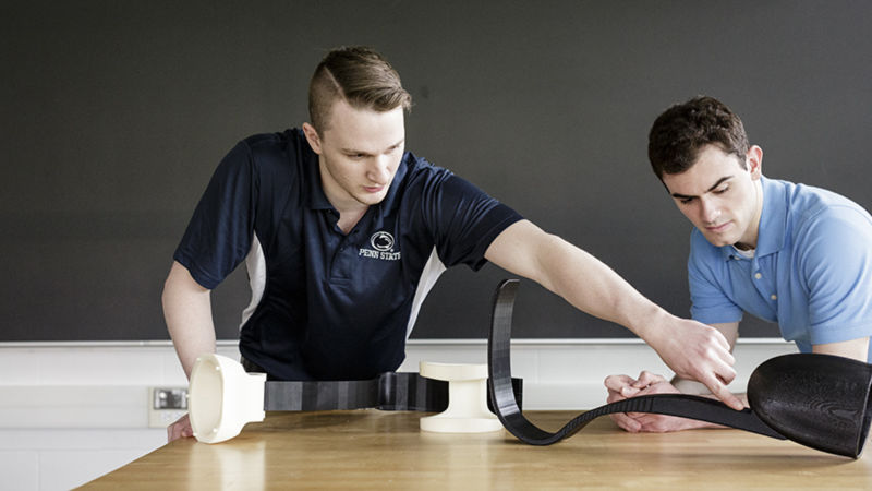Miller (left) and Bleicher display the leg prosthetic, which was entered in the ASME IAM 3D Challenge.