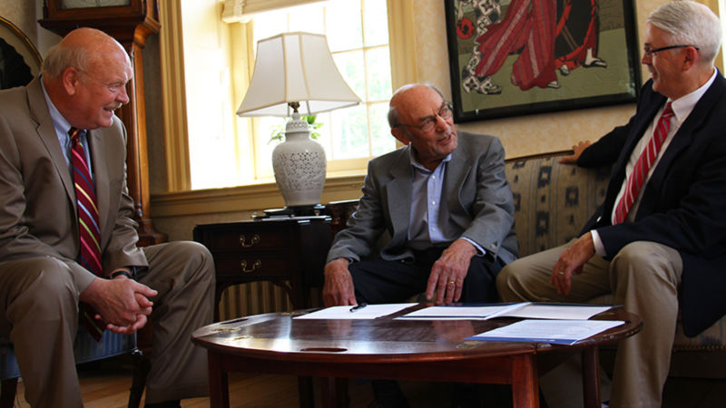 Rolf Schmidt (center) discusses the scholarship with Chancellor R. Keith Hillkirk (left) and David Delozier, Director of Development and Alumni Relations.