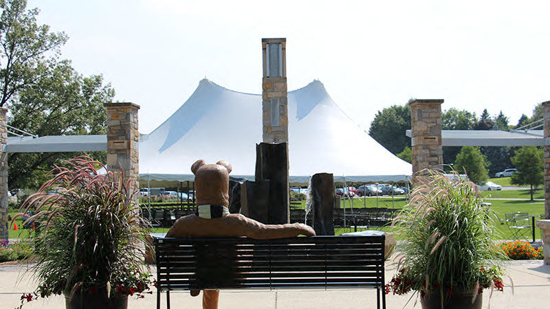 The Lion Bench with the Welcome Week tent behind it.