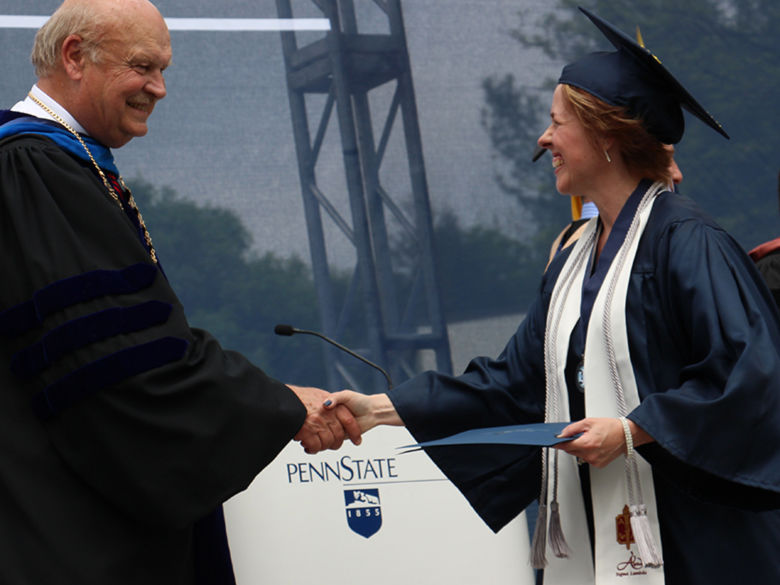 Adult student earning her diploma at graduation