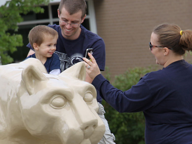Penn State family enjoying the Lion Shrine