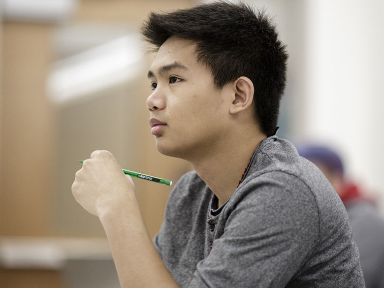 Student listening to a lecture in class