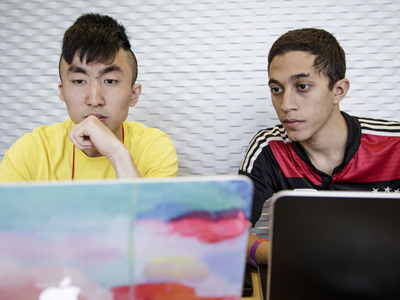Students collaborating on their computers