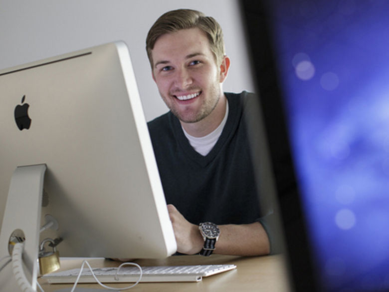 Student sitting in computer lab