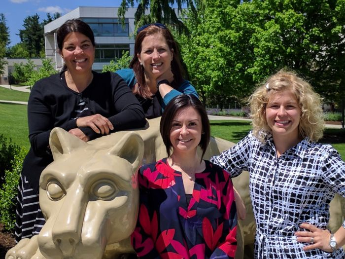 Learning Center employees with Nittany Lion Statue