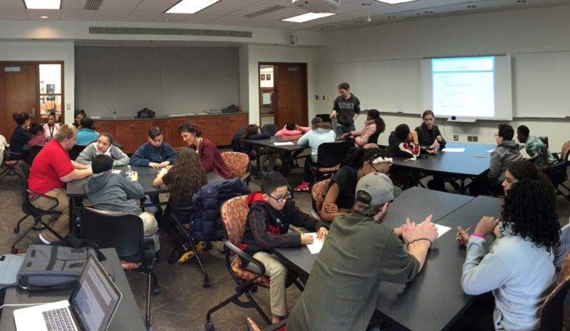Students work in groups at the Creativity Workshop