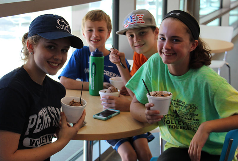 Kids enjoying Creamery ice cream at Homecoming