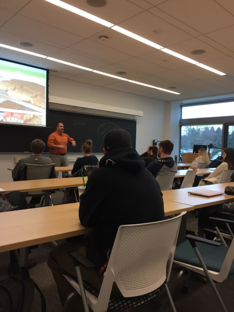 Students listen to a presentation by Waffatopia co-owner