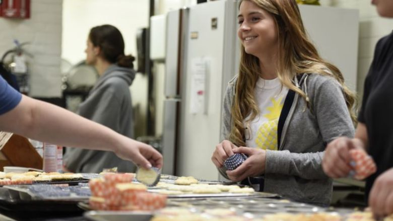 Penn State Berks students prepare and serve a multiple course meal for residents at the Opportunity House.