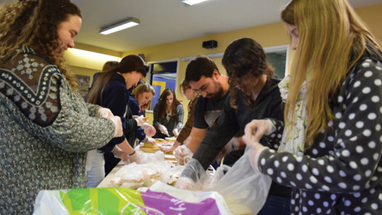 Penn State Berks students formed an assembly line to make as many sandwiches for the homeless as possible between sessions.