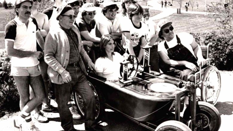 """Students in the bath tub derby """"race car"""" they designed"""