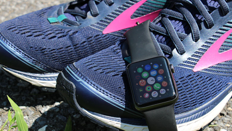 An Apple Watch and a pair of running shoes