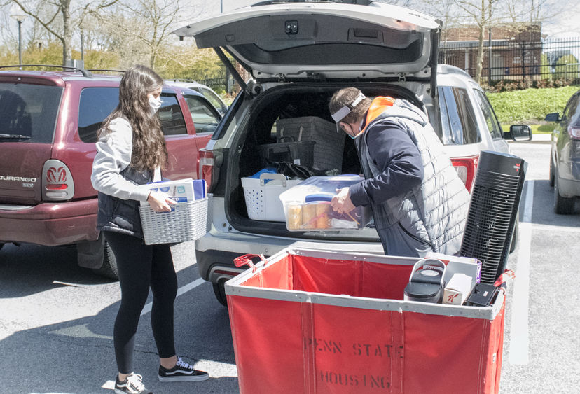 Student packing belongings in car