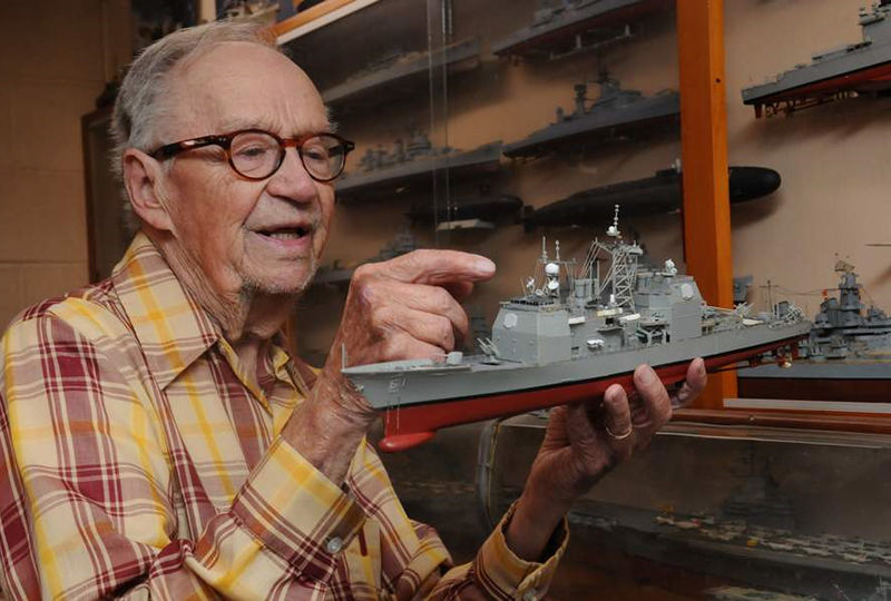 Ed Wiswesser is pictured with a model train.