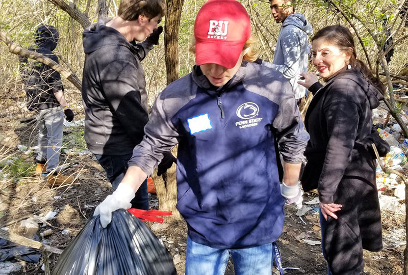 Students help cleanup park trails.